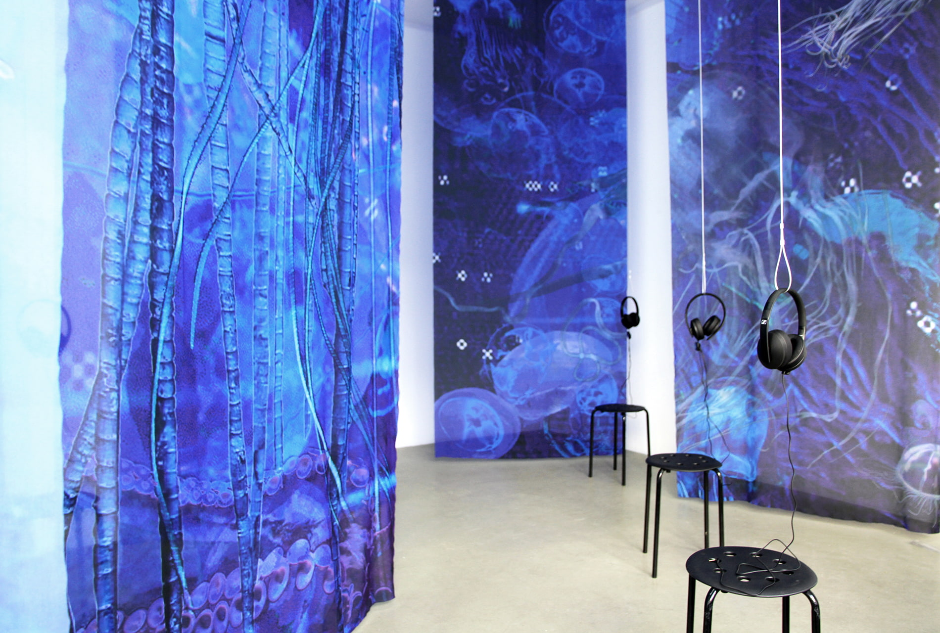 Installation view of Einen Riesigen Schwarm at Digital Art Space Munich - large-format textile banners and sound installation